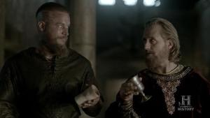 Ragnar (Travis Fimmel) and King Ecbert (Linus Roache) do not approve of drinking poisoned wine in Episode 4 (entitled Scarred) Season 5 of History Channel's Vikings