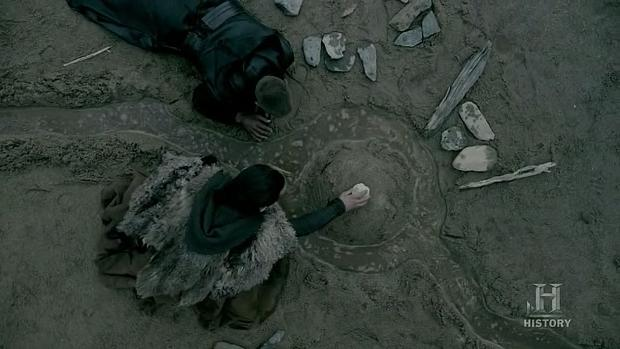 Ragnar (Travis Fimmel) and Athelstan (George Blagden) play in the sand in Episode 6 (entitled Born Again) Season 3 of History Channel's Vikings